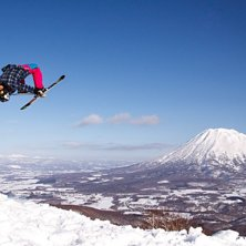 Nicole Lejdeby - Backflip on a bluebird slush day .